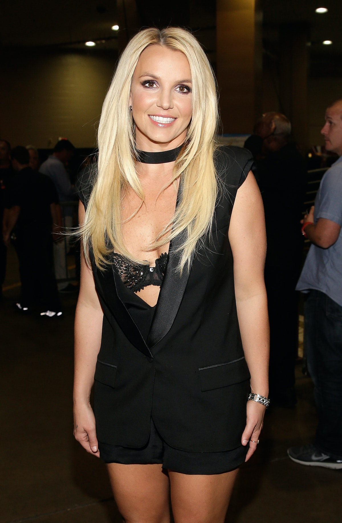 Britney Spears, shown here smiling in a black dress in Las Vegas, is so over the paparazzi.