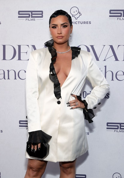 Celebrity Leo Demi Lovato shows off her style during red carpet event.