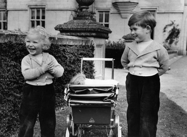 Princess Anne (left) and Prince Charles laughing together as children.