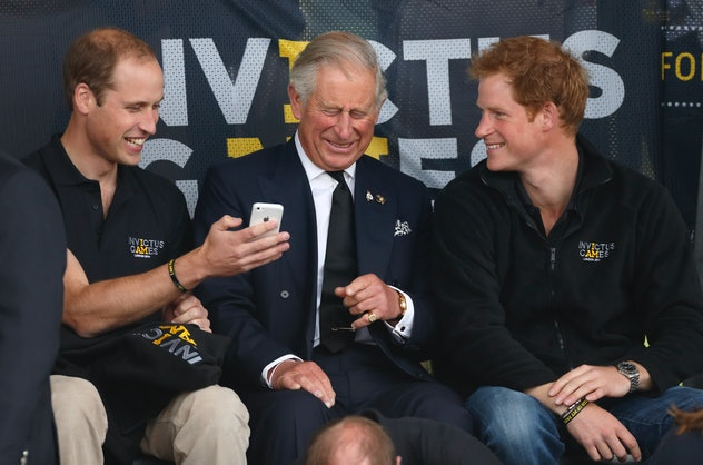 Prince Harry, Prince Charles, and Prince William at the 2014 Invictus Games.