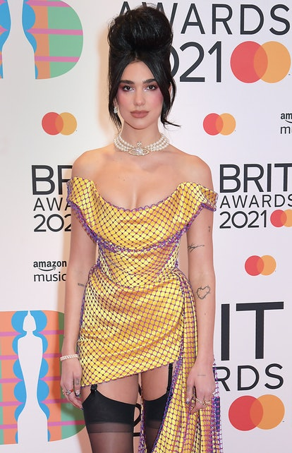 Celebrity Leo Dua Lipa embodies her star sign energy as she arrives at The BRIT Awards.