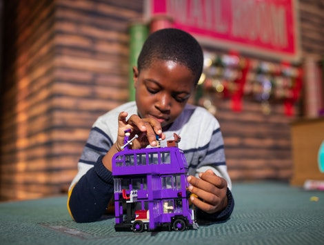 Peter Olunloyo, 8, plays with a Harry Potter Knight bus toy by LEGO, which was named in the top 12 t...
