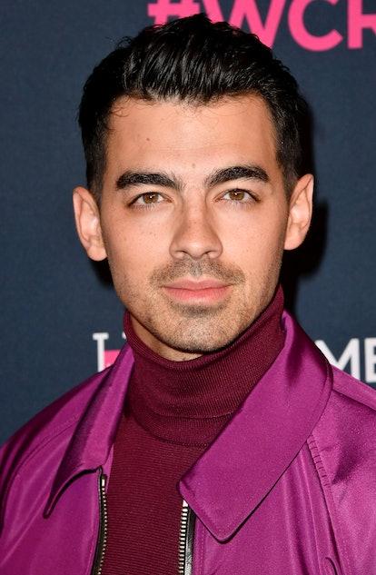 Celebrity Leo Jonas attends event in bright jacket.