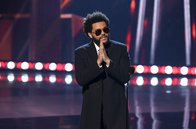 LOS ANGELES, CALIFORNIA - MAY 27: (EDITORIAL USE ONLY) The Weeknd accepts the Song of the Year award for 'Blinding Lights' onstage at the 2021 iHeartRadio Music Awards at The Dolby Theatre in Los Angeles, California, which was broadcast live on FOX on May 27, 2021. (Photo by Kevin Winter/Getty Images for iHeartMedia)