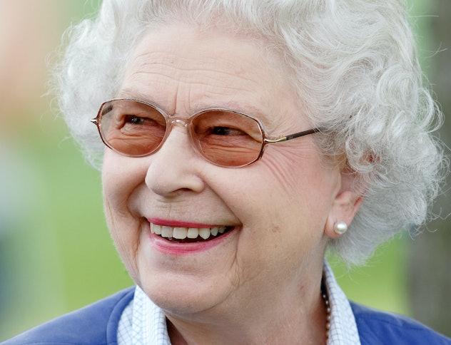 Queen Elizabeth smiling at the 2018 Royal Windsor Horse Show.
