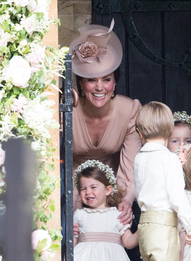Princess Charlotte and Kate Middleton laugh at Pippa Middleton's wedding.