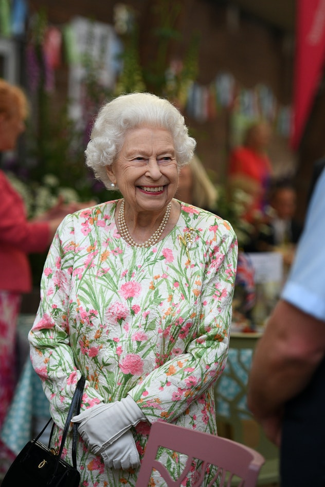 ST AUSTELL, ENGLAND - JUNE 11: Queen Elizabeth II smiles as she meets people from communities across...