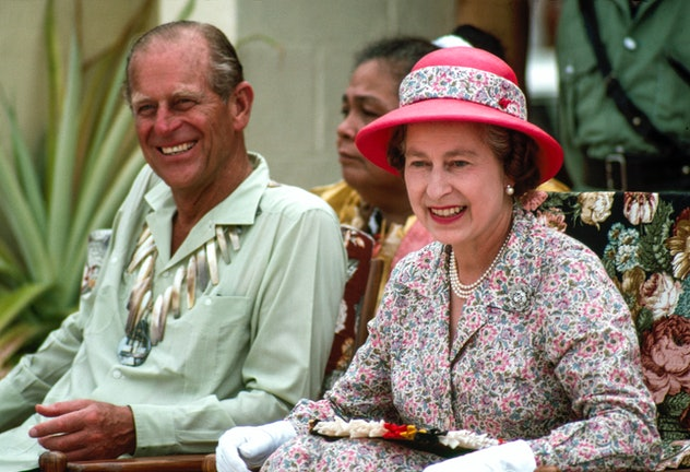 Queen Elizabeth and Prince Philip laugh together in Tuvalu In The South Pacific.
