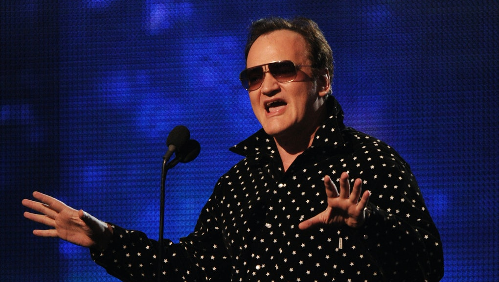 Film director Quentin Tarantino introduces Drake, Eminem and Lil Wayne during the Grammy Show at the...