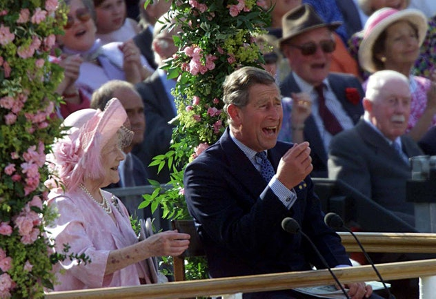 Prince Charles laughs with his grandmother, the Queen Mother.