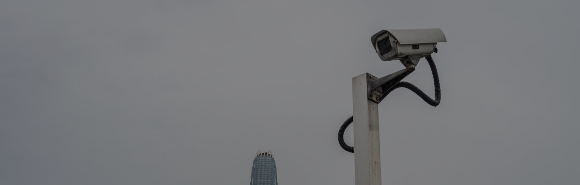 HONG KONG, CHINA - 2021/06/22: The CCTV camera monitor is set in front of the city skyline at the Vi...