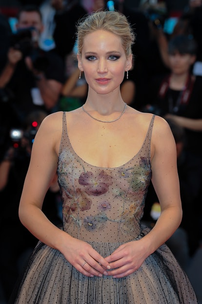 Actress and celebrity Leo Jennifer Lawrence walks the red carpet.
