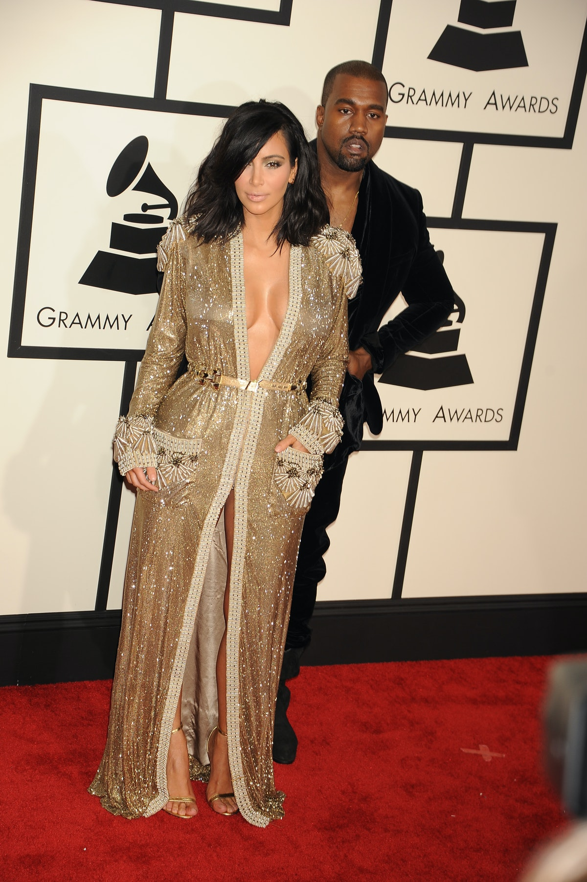 Rapper Kanye West and TV personality Kim Kardashian arrive at The 57th Annual GRAMMY Awards held at the Staples Center. (Photo by Frank Trapper/Corbis via Getty Images)