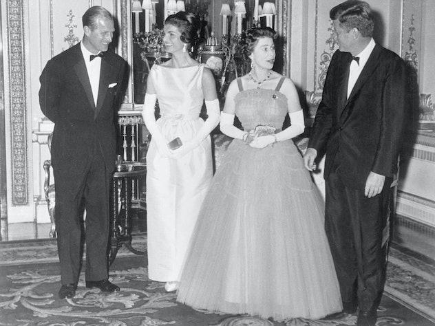 Queen Elizabeth greets President John F. Kennedy.