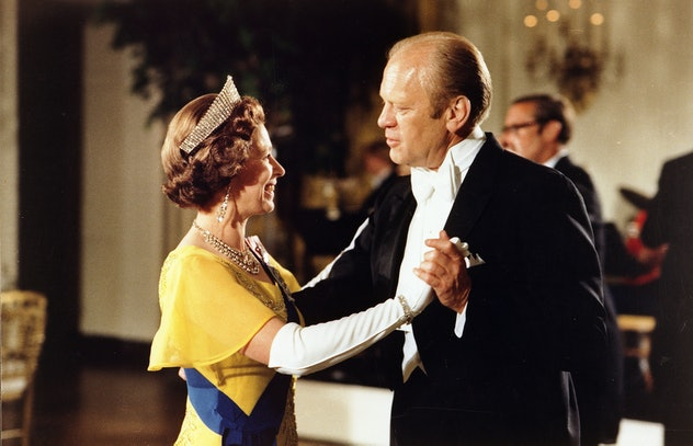President Ford dances with Queen Elizabeth.