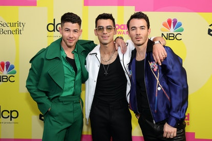 Nick Jonas, Joe Jonas, and Kevin Jonas of Jonas Brothers pose backstage at the 2021 Billboard Music ...