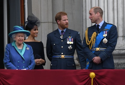 LONDON, UNITED KINGDOM - JULY 1O: Queen Elizabeth ll, Meghan, Duchess of Sussex, Prince Harry, Duke of Sussex and Prince William, Duke of Cambridge stand on the balcony of Buckingham Palace to view a flypast to mark the centenary of the Royal Air Force (RAF) on July 10, 2018 in London, England.  (Photo by Anwar Hussein/Getty Images)