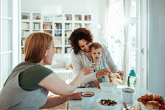 Close up of a young family having breakfast together