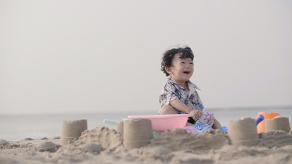 If your baby eats a bunch of sand, experts say to monitor them.