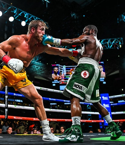 Former world welterweight king Floyd Mayweather (R) and YouTube personality Logan Paul (L) fight in ...
