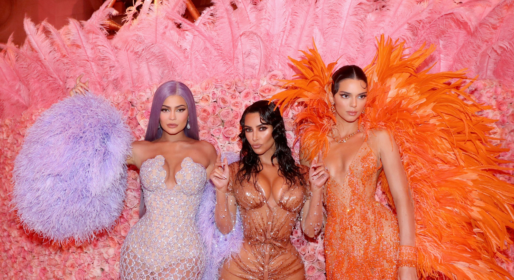 Kylie Jenner, Kim Kardashian West, and Kendall Jenner attend the 2019 Met Gala.