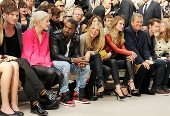 LONDON, ENGLAND - SEPTEMBER 19:  (L to R) Dan Gillespie, Ellie Goulding, Kanye West, Sienna Miller, Gemma Arterton, Rosie Huntington-Whiteley, Mario Testino, Andy Murray and Kim Sears attends at the Burberry Spring Summer 2012 Womenswear Show at Kensington Gardens on September 19, 2011 in London, England.  (Photo by Dave M. Benett/Getty Images)
