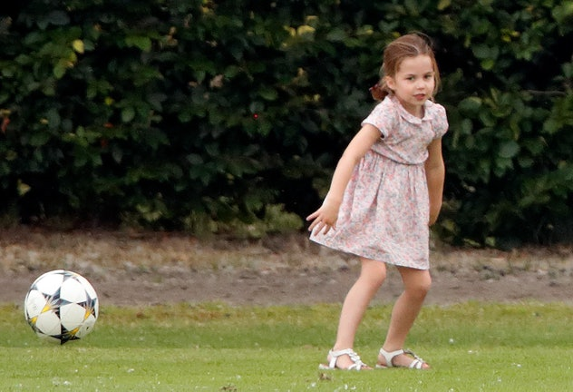 Princess Charlotte of Cambridge plays football as she attends the King Power Royal Charity Polo Match at Billingbear Polo Club on July 10, 2019 in Wokingham, England.