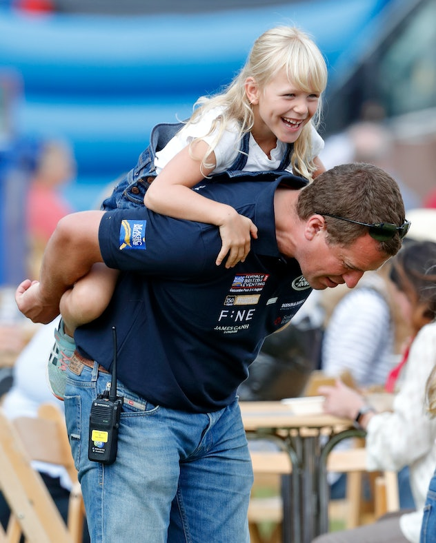 Peter Phillips gives daughter Isla Phillips a piggyback at the Festival of British Eventing on August 2, 2019 in Stroud, England.