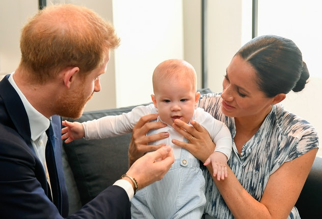 Prince Harry, Meghan Markle fawn over their son Archie Mountbatten-Windso on September 25, 2019 in Cape Town, South Africa. (Photo by Toby Melville/Pool/Samir Hussein/WireImage)