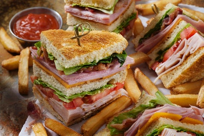 Roast Chicken Club House Sandwich with Lettuce, Tomato,Ham, Bacon Cheddar Cheese and Mayo