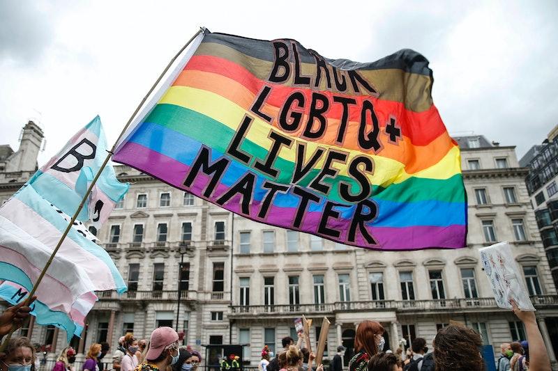 A Black LGBTQ+ Lives Matter flag flies during Black Trans Lives Matter march. The origins of pride ...