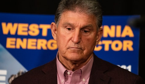 MORGANTOWN, WV - JUNE 03:   U.S. Sen. Joe Manchin (D-WV) attends a news conference at the Marriott Hotel at Waterfront Place June 3, 2021 in Morgantown, West Virginia. Manchin was on hand for the announcement of an agreement between Steel of West Virginia, Dominion Energy and Orsted Offshore North America to build and install wind turbines along the Atlantic Coast using a ship to be built by Orsted with steel from the state.  (Photo by Michael Swensen/Getty Images)