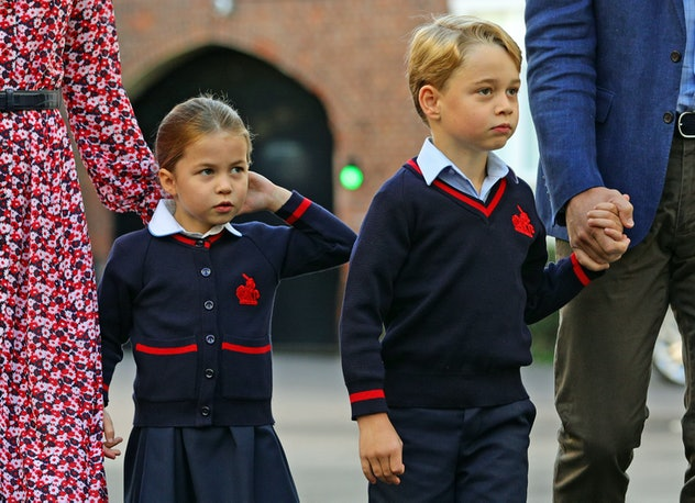 Prince George and Princess Charlotte, two of Queen Elizabeth's great-grandchildren, arrive for their first day of school at Thomas's Battersea in London on September 5, 2019.