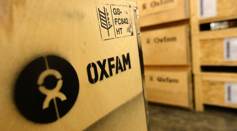Detailed view of the Oxfam logo on a crate of Humanitarian Aid bound for Oxfam onto a waiting lorry outside Oxfam's warehouse in Bicester.   (Photo by Andrew Matthews/PA Images via Getty Images)
