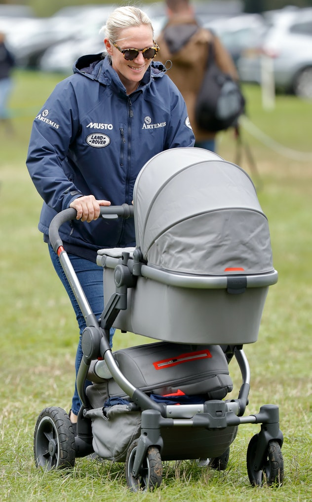 Zara Tindall pushes a buggy as she attends the Whatley Manor Horse Trials at Gatcombe Park on September 8, 2018 in Stroud, England. (Photo by Max Mumby/Indigo/Getty Images)