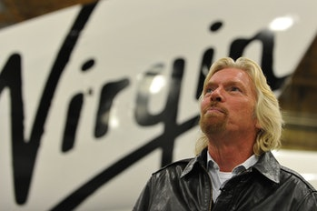 Sir Richard Branson speaks to AFP during an interview  before the official unveiling of Virgin Galactic's SpaceShipTwo, the world's first commercial manned spacecraft, at the Mojave Air and Space Port in Mojave, California on December 7, 2009.       AFP PHOTO/Robyn BECK (Photo credit should read ROBYN BECK/AFP via Getty Images)