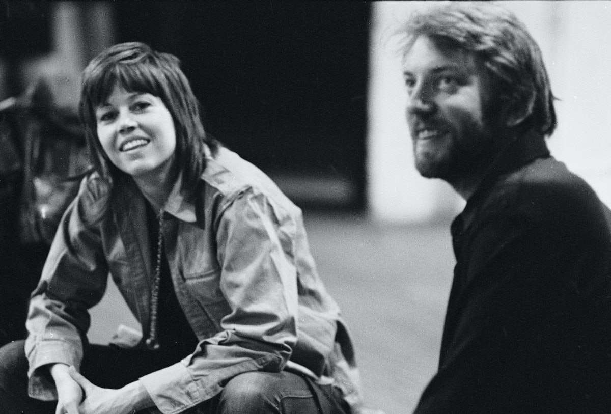 Actors Jane Fonda and Donald Sutherland sit during a performance of the anti-war road show 'F.T.A.' ...