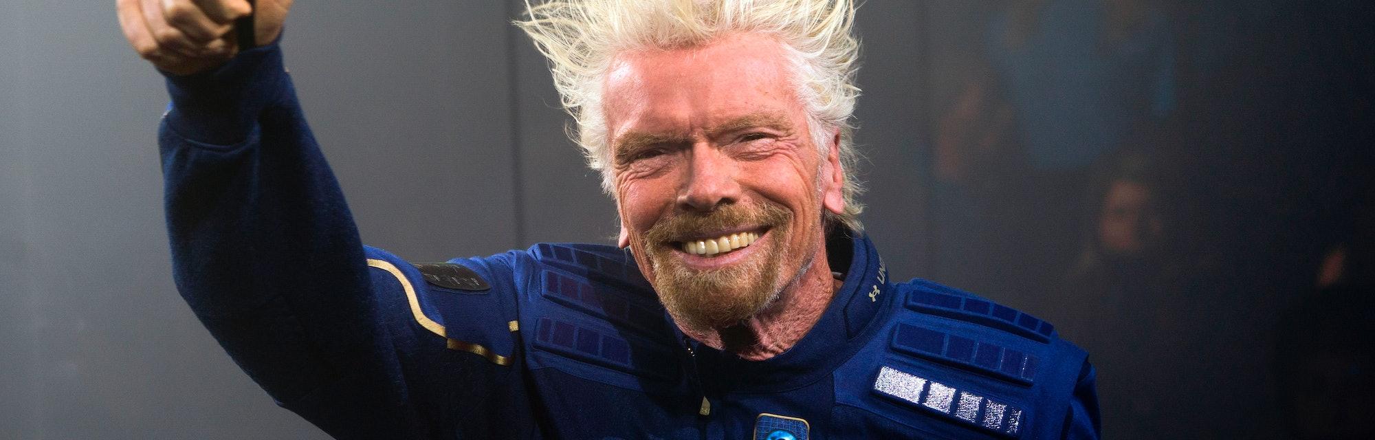 Virgin Galactic Founder Sir Richard Branson demonstrates a spacewear system, designed for Virgin Gal...
