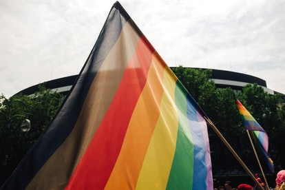 A rainbow pride flag with black and brown stripes, representing black and brown folks' inclusion in pride.