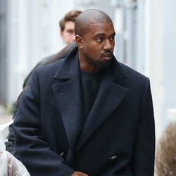Kanye West wears a fall-appropriate coat while leaving Michiko Sushino restaurant with his daughter ...
