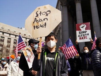 """NEW YORK, April 4, 2021 -- People rally to protest against anti-Asian hate crimes on Foley Square in New York, the United States, April 4, 2021. A big """"Stop Asian Hate"""" rally and march was held here on Sunday. (Photo by Wang Ying/Xinhua via Getty) (Xinhua/Wang Ying via Getty Images)"""