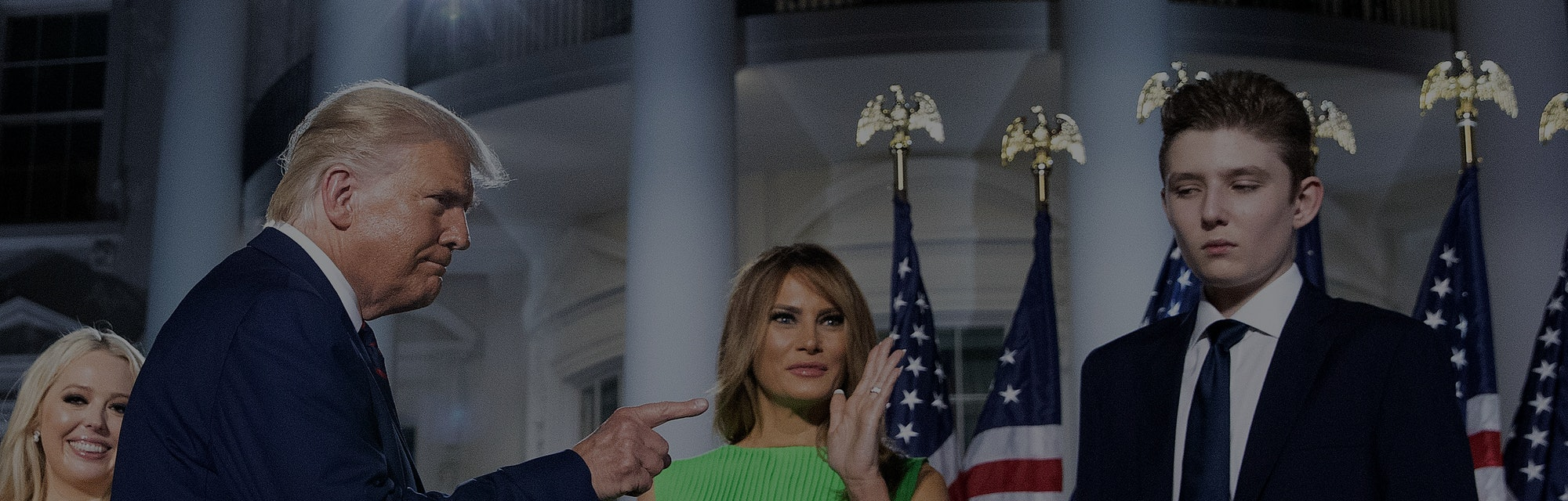 WASHINGTON, DC - AUGUST 27: U.S. President Donald Trump (L) gestures toward first lady Melania Trump and his son Barron Trump after delivering his acceptance speech for the Republican presidential nomination on the South Lawn of the White House August 27, 2020 in Washington, DC. Trump gave the speech in front of 1500 invited guests. (Photo by Chip Somodevilla/Getty Images)