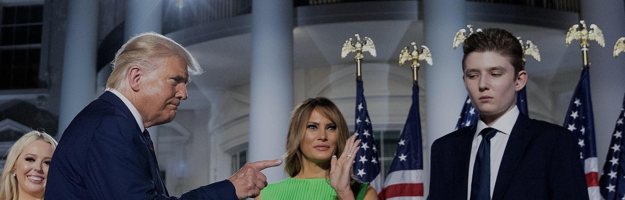 WASHINGTON, DC - AUGUST 27: U.S. President Donald Trump (L) gestures toward first lady Melania Trump...