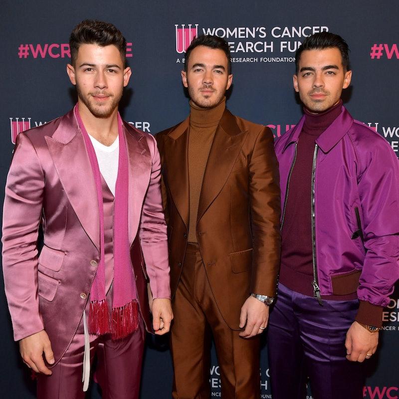 Nick Jonas, Kevin Jonas, and Joe Jonas detail their 2013 breakup in 'Blood' memoir. (Photo by Emma M...