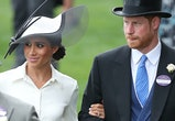 Britain's Prince Harry, Duke of Sussex (R) and his wife Britain's Meghan, Duchess of Sussex attend day one of the Royal Ascot horse racing meet, in Ascot, west of London, on June 19, 2018. - The five-day meeting is one of the highlights of the horse racing calendar. Horse racing has been held at the famous Berkshire course since 1711 and tradition is a hallmark of the meeting. Top hats and tails remain compulsory in parts of the course while a daily procession of horse-drawn carriages brings the Queen to the course. (Photo by Daniel LEAL-OLIVAS / AFP)        (Photo credit should read DANIEL LEAL-OLIVAS/AFP via Getty Images)