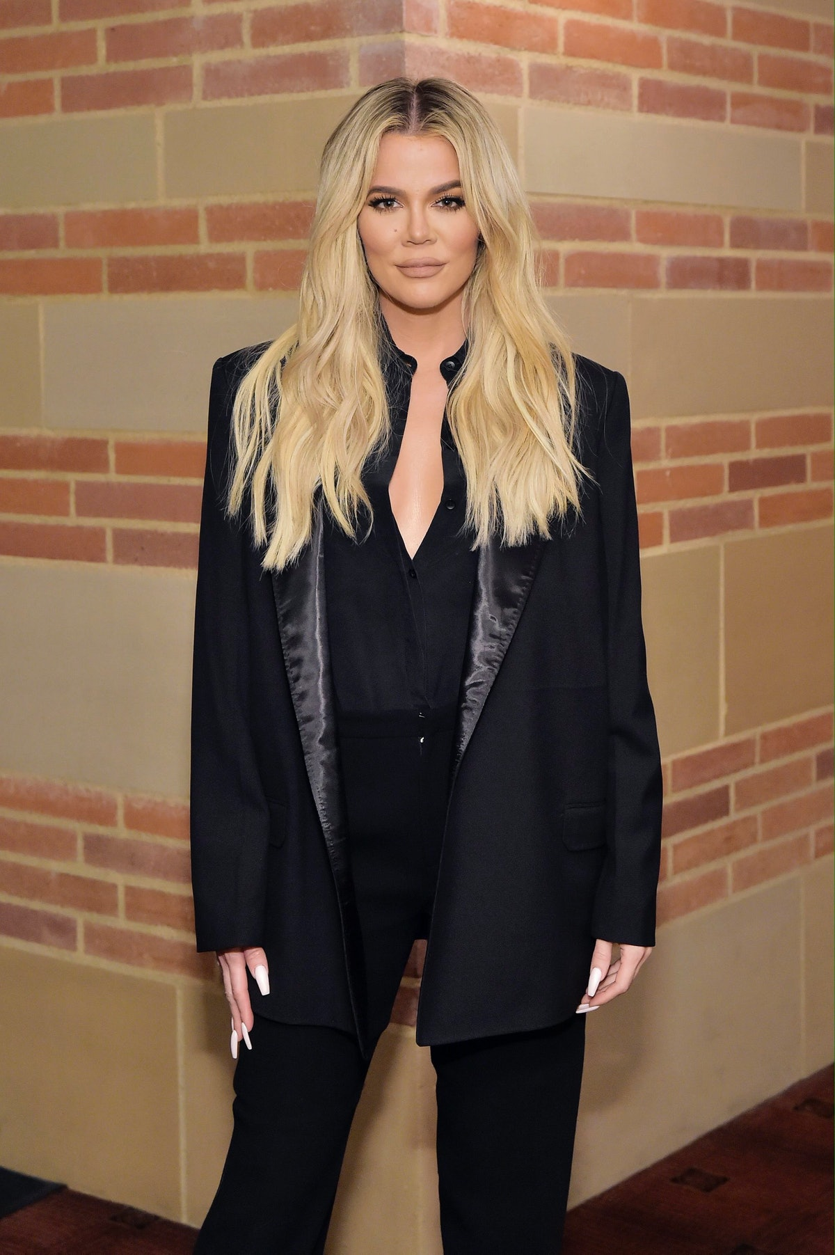 Comeback queen Khloé Kardashian, pictured here in blonde hair and an all black ensemble, just went off on another uninformed hater.