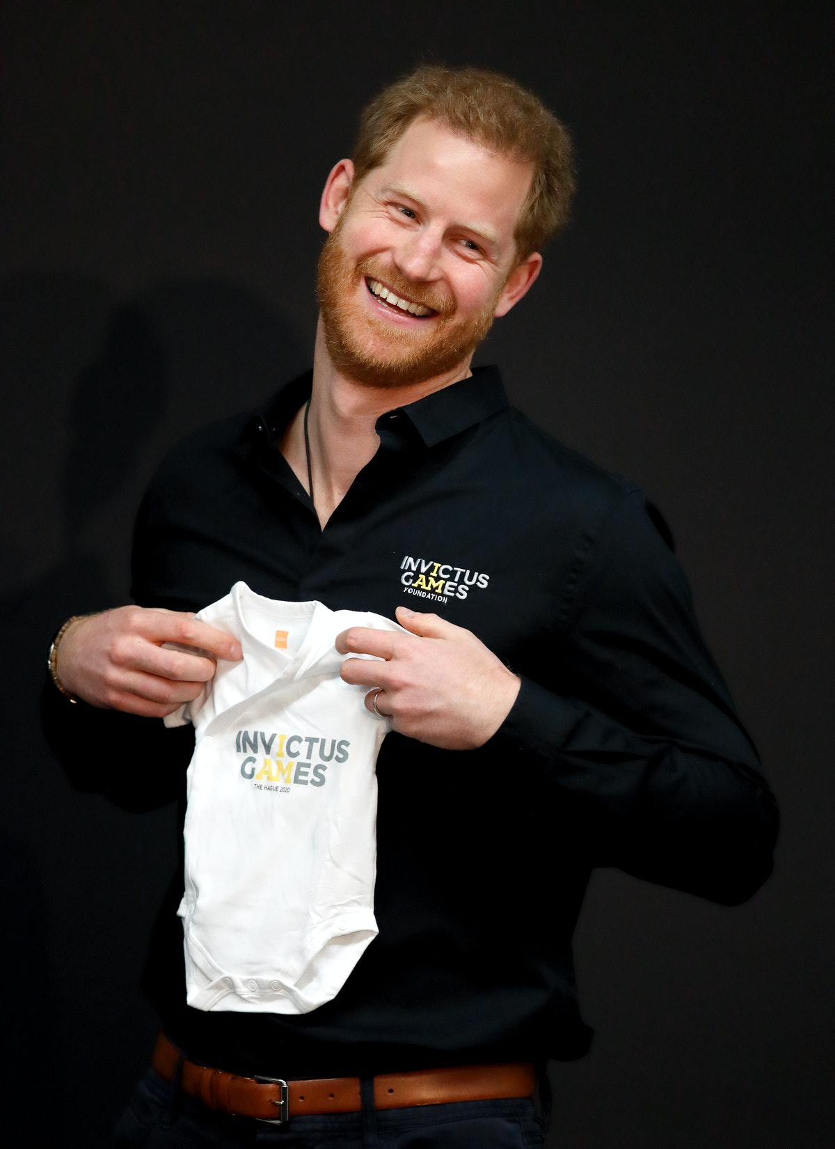 THE HAGUE, NETHERLANDS - MAY 09: (EMBARGOED FOR PUBLICATION IN UK NEWSPAPERS UNTIL 24 HOURS AFTER CREATE DATE AND TIME) Prince Harry, Duke of Sussex is presented with an Invictus Games baby grow for his newborn son Archie as he visits Sportcampus Zuiderpark as part of a programme of events to mark the official launch of the Invictus Games The Hague 2020 on May 9, 2019 in The Hague, Netherlands. (Photo by Max Mumby/Indigo/Getty Images)