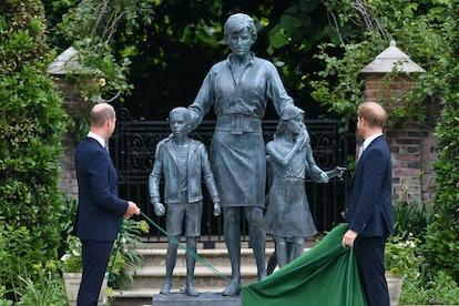 Britain's Prince William, Duke of Cambridge (L) and Britain's Prince Harry, Duke of Sussex unveil a ...
