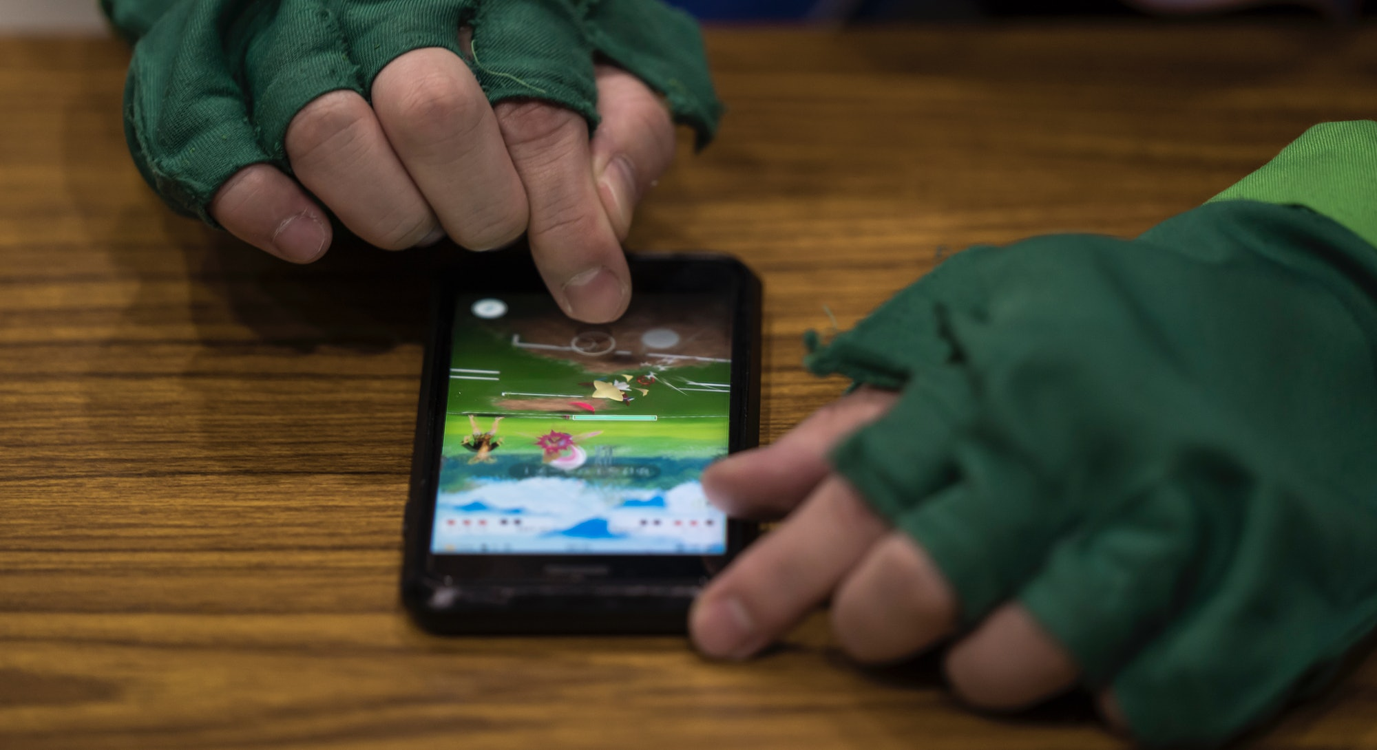 TOKYO, JAPAN - JANUARY 11: A visitor plays the Pokemon Go augmented-reality game on smartphones duri...