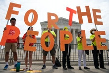 UNITED STATES - June 09: Demonstrators hold up signs as the Declaration for American Democracy coali...